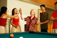 Three generation family around pool table - Jade Lee
