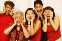 Three generation family, looking at camera, hands on head, screaming - Jade Lee
