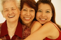 Three generations of women, looking at camera, smiling - Jade Lee