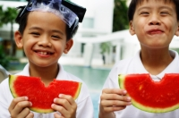 Two boys holding slices of watermelon, smiling - Jade Lee