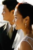 Bride and groom looking away - Marcus Mok