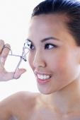 Headshot of woman using eyelash curler - Alex Microstock02