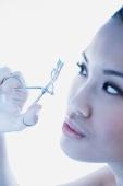 Woman using eyelash curler - Alex Microstock02