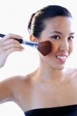 Woman applying make-up with brush - Alex Microstock02