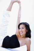 Woman in black tube top, stretching, touching foot - Alex Microstock02