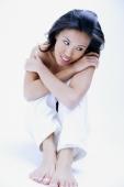 Woman sitting, hugging knee, arms crossed - Alex Microstock02