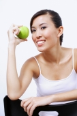 Woman holding apple, looking at camera - Alex Microstock02