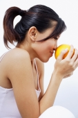 Woman smelling orange, sideview - Alex Microstock02