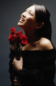 Young woman with bouquet of flowers, looking up - Alex Microstock02