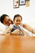 Father holding young daughter - Alex Microstock02