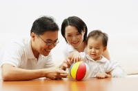 Family with one child, daughter playing with ball - Alex Microstock02