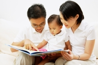 Family with one child, looking at book - Alex Microstock02
