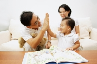 Family with one child, father giving daughter high five - Alex Microstock02