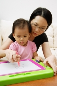 Mother teaching daughter to draw - Alex Microstock02