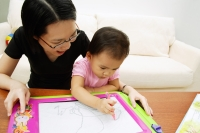 Mother watching daughter draw - Alex Microstock02