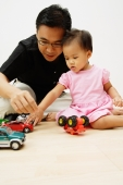 Father and daughter playing with cars - Alex Microstock02