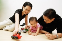 Father, mother and daughter playing with cars - Alex Microstock02