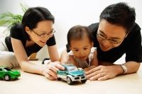 Family with one child, playing with cars - Alex Microstock02