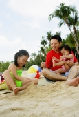Father with two children playing on beach - Alex Microstock02