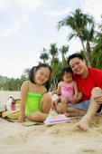 Father with two children on beach, looking at camera - Alex Microstock02