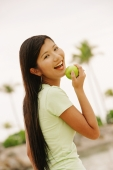 Woman with apple, looking at camera - Alex Microstock02