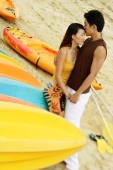 Couple on beach, man kissing woman's forehead - Alex Microstock02