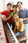 Family with two children, standing around piano, portrait - Alex Microstock02