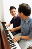 Father and son playing piano, side by side - Alex Microstock02