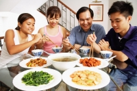 Family at home eating around dining table - Alex Mares-Manton