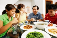 Family eating dinner at home - Alex Mares-Manton