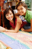 Mother and daughter on bed, looking at camera - Alex Microstock02