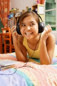 Young woman wearing headphones, looking away - Alex Microstock02
