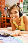 Young woman wearing headphones, looking at camera - Alex Microstock02