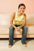 Young woman, sitting on sofa, looking at camera, portrait - Alex Microstock02