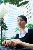 Business woman using laptop, low angle view - Alex Microstock02