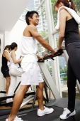 Couples in gym, walking on treadmill - Alex Microstock02