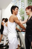 Couple in gym, woman wiping man's face - Alex Microstock02