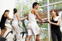 Couples in gym, walking on treadmill, in a row - Alex Microstock02
