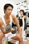Young men working out in gym, looking away - Alex Microstock02