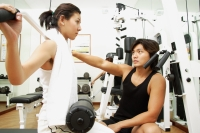 Couple working out in gym, weight training - Alex Microstock02