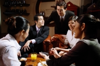 Executives sitting together having drinks - Alex Microstock02