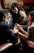Group of young executives using PDA, having discussion - Alex Microstock02