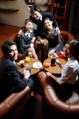 Group of young executives in a entertainment club, looking at camera - Alex Microstock02