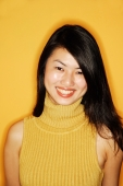 Young woman in yellow turtleneck, smiling at camera, portrait - Alex Microstock02