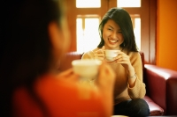 Two young women drinking tea - Alex Microstock02