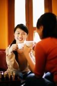 Two young women having tea - Alex Microstock02