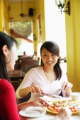Young women at cafe, eating pizza - Alex Microstock02