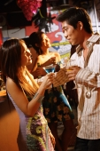 Couples in night club, with drinks, talking - Alex Microstock02