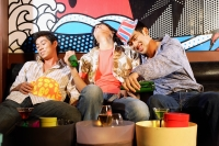 Three young men, at entertainment club, drinking - Alex Microstock02