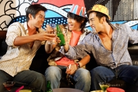 Three young men, at entertainment club, toasting - Alex Microstock02